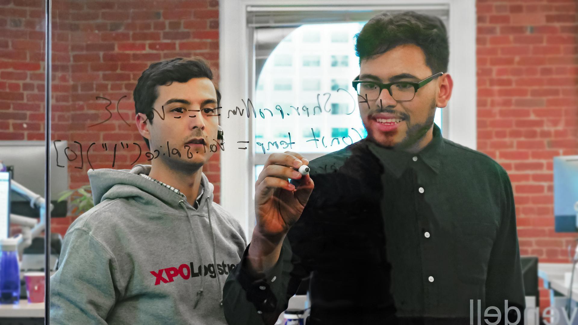 XPO engineers whiteboarding