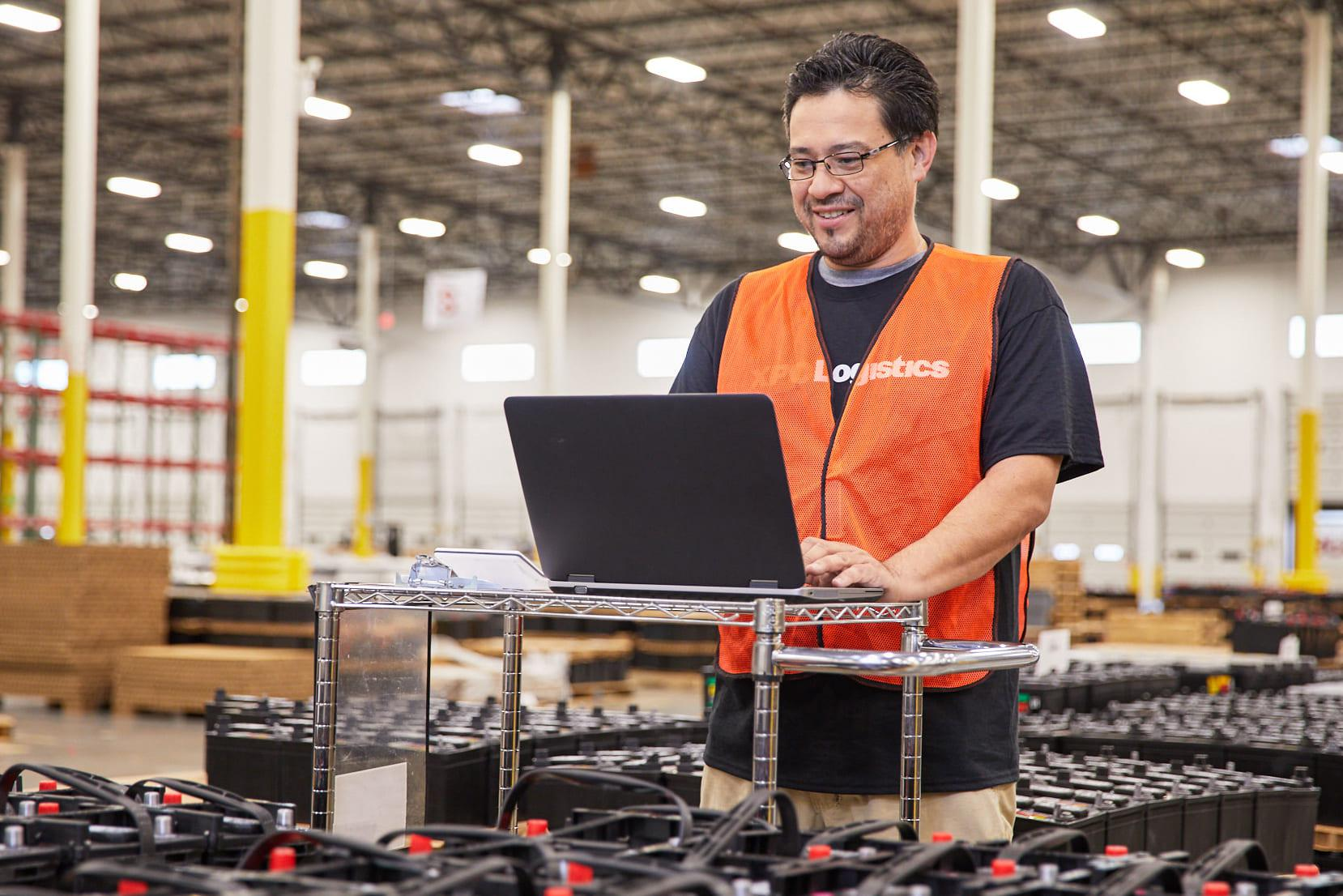 XPO warehouse employee working on computer