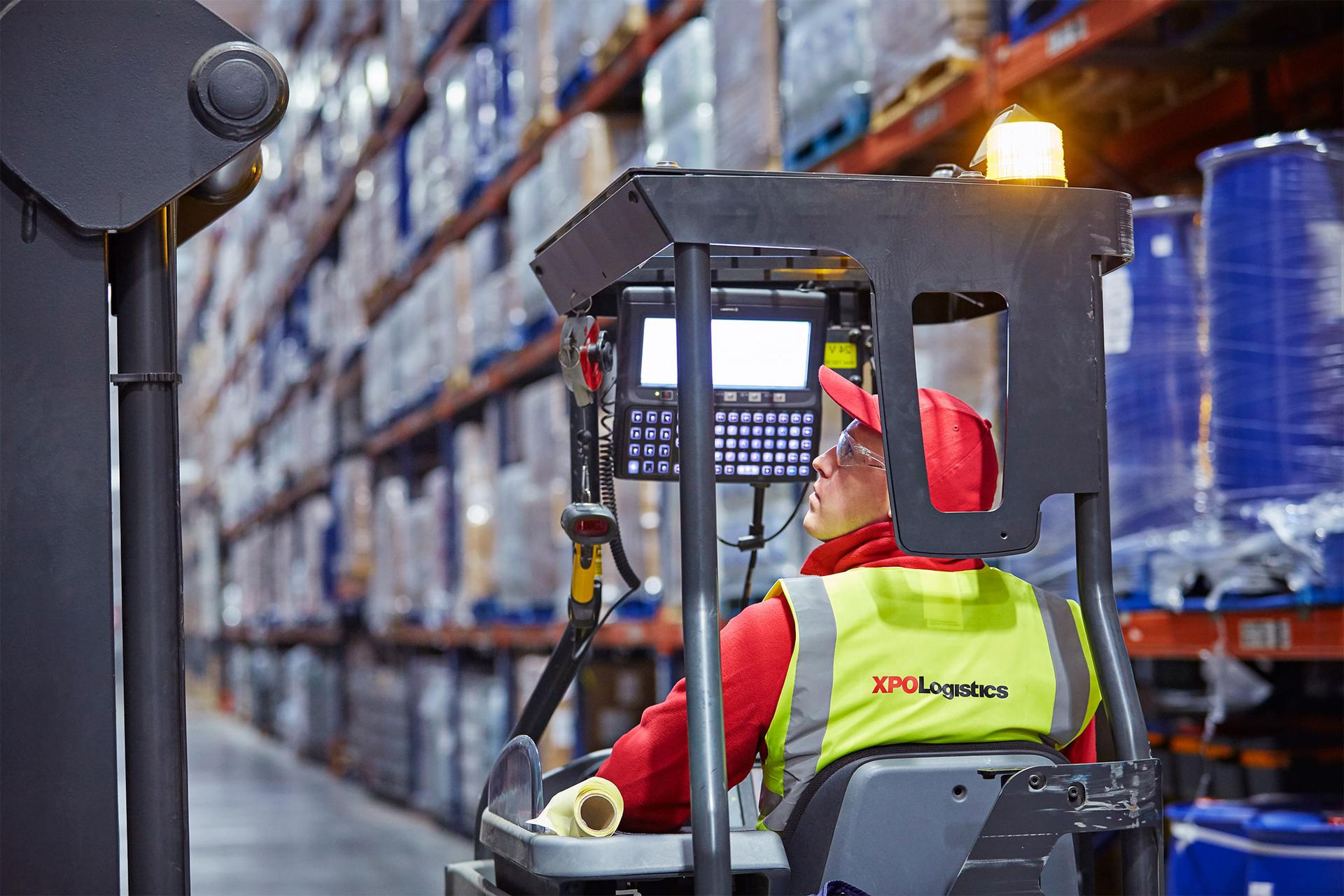 XPO employee driving forklift