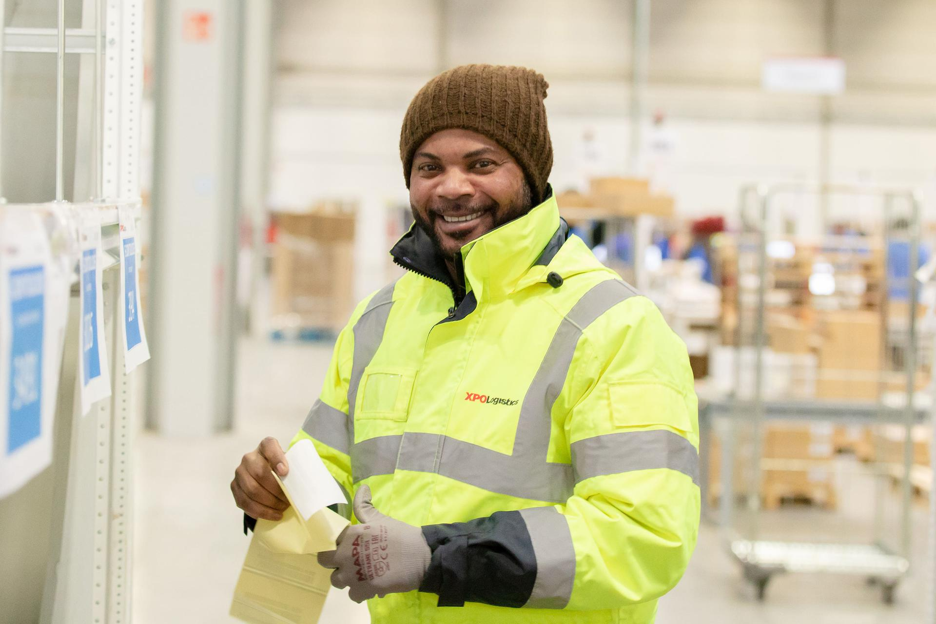 XPO supply chain employee smiling