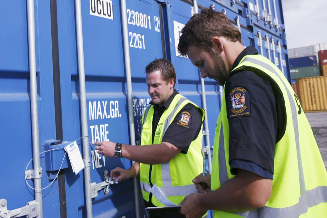 Customs agents inspecting a container in mexican border
