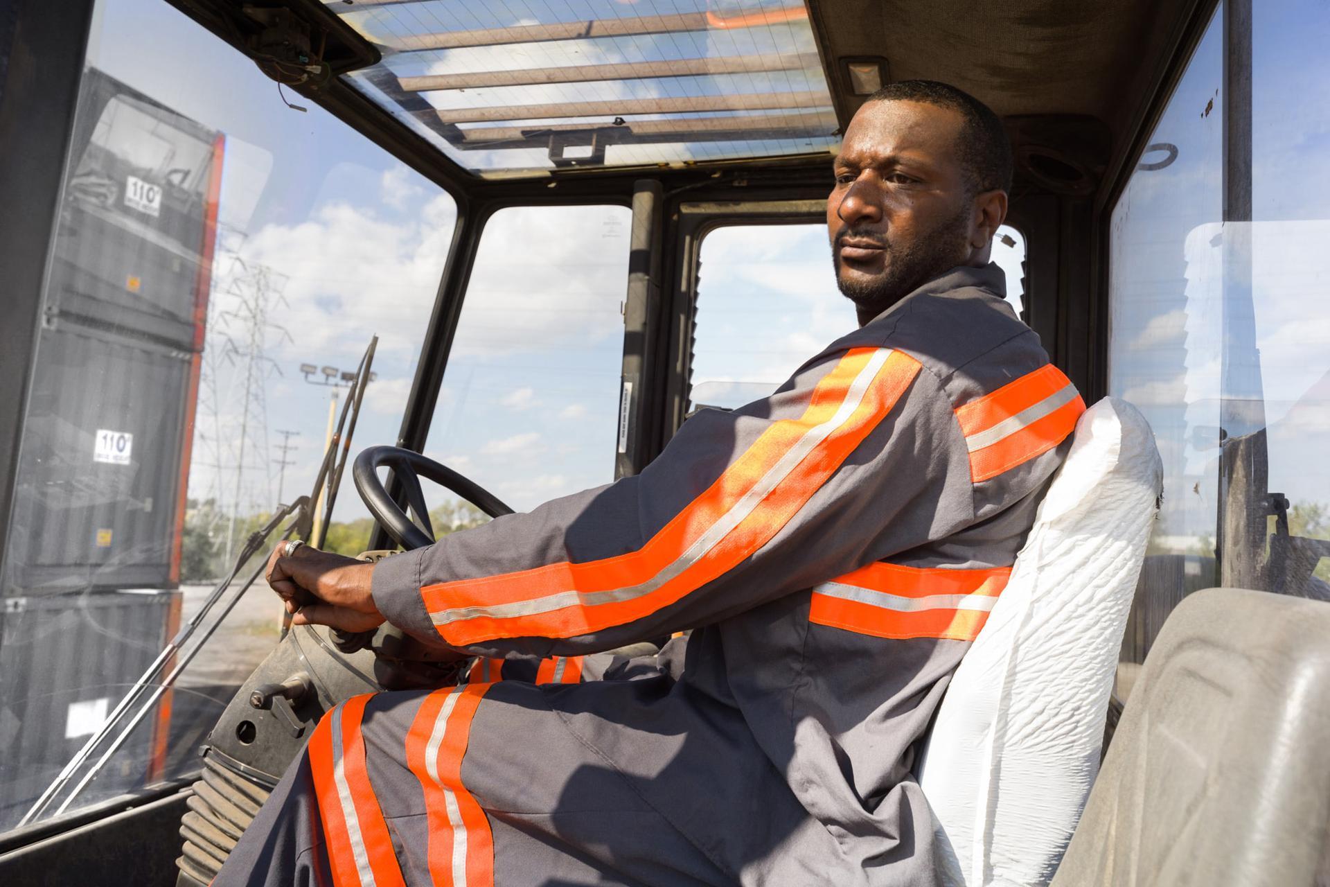 Employee operating crane