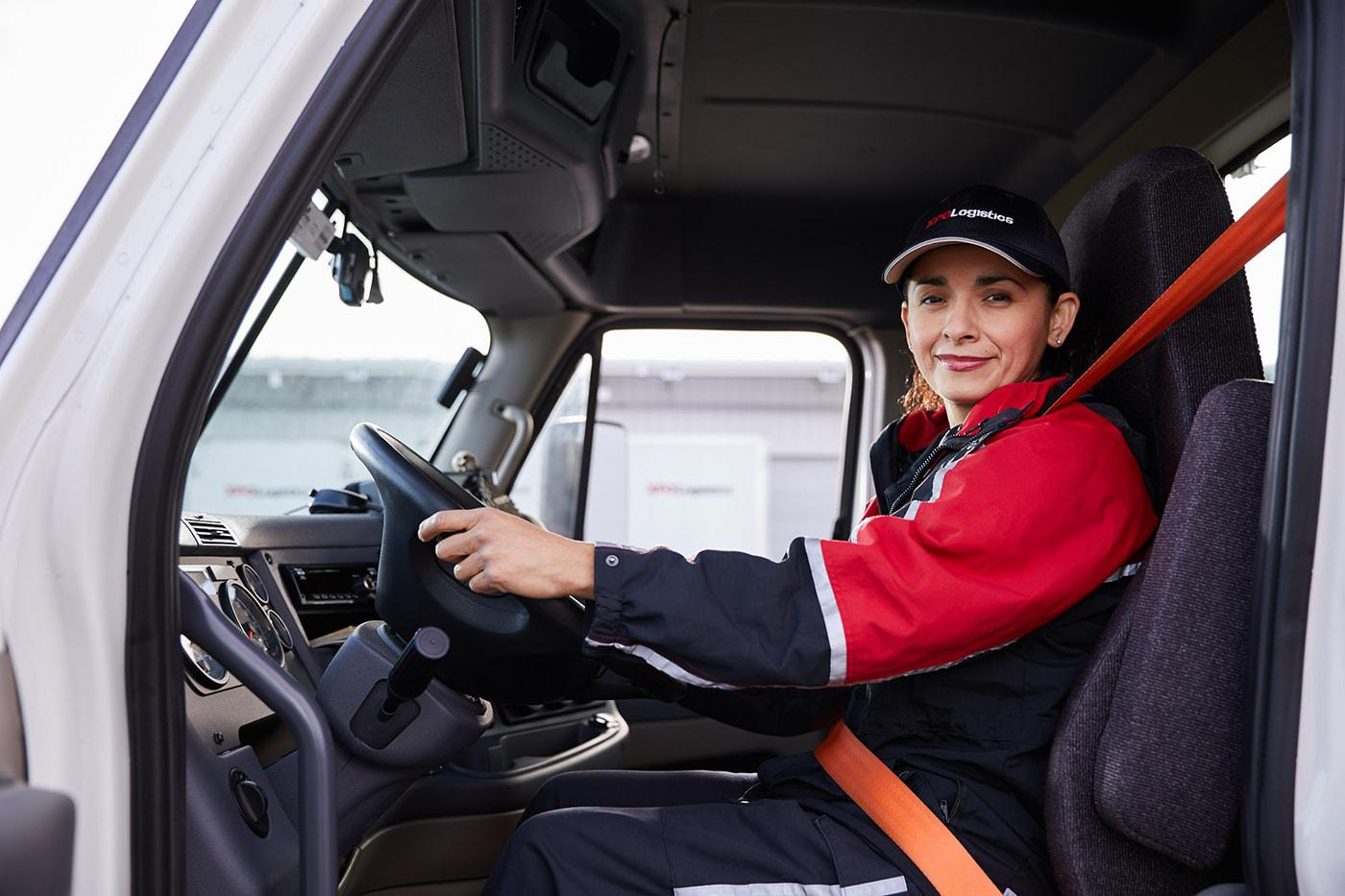 XPO female driver inside cabin of truck