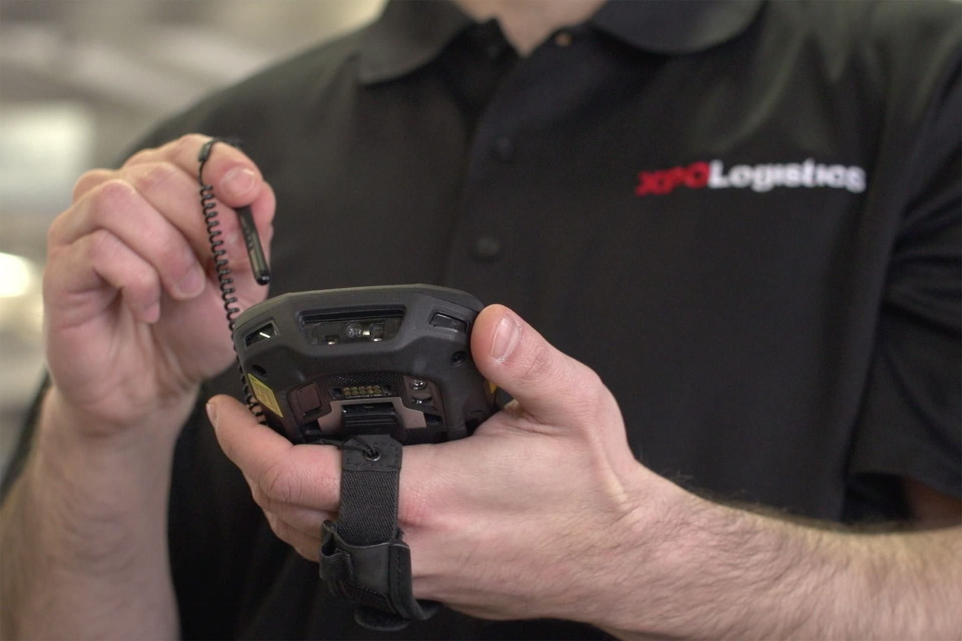 XPO LTL Driver with a handheld device