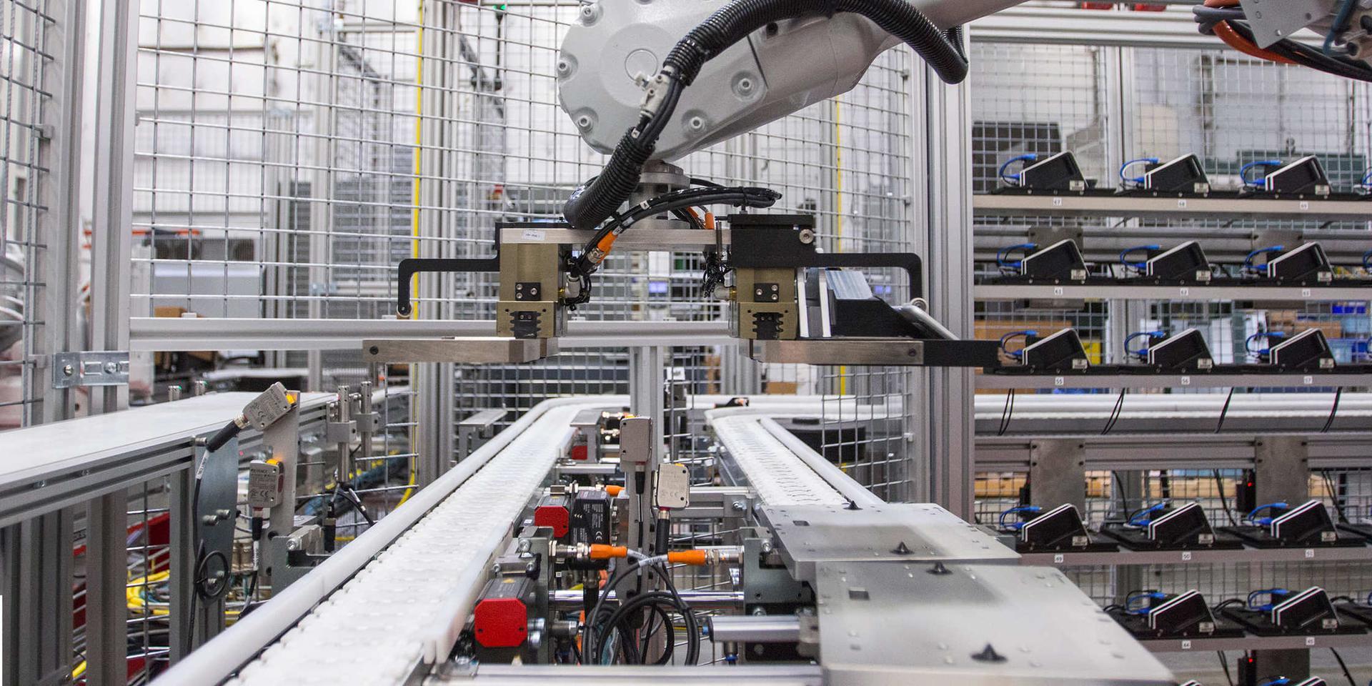 XPO robot arms moving electronics