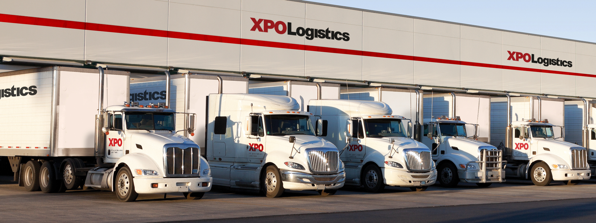 Large distribution center with XPO trucks.