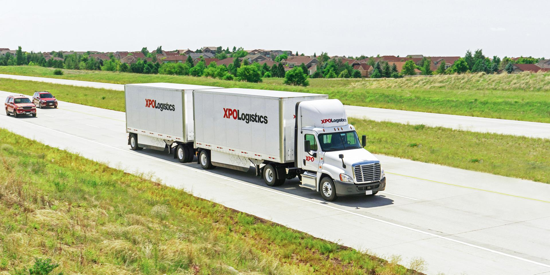 XPO LTL double trailer truck on highway