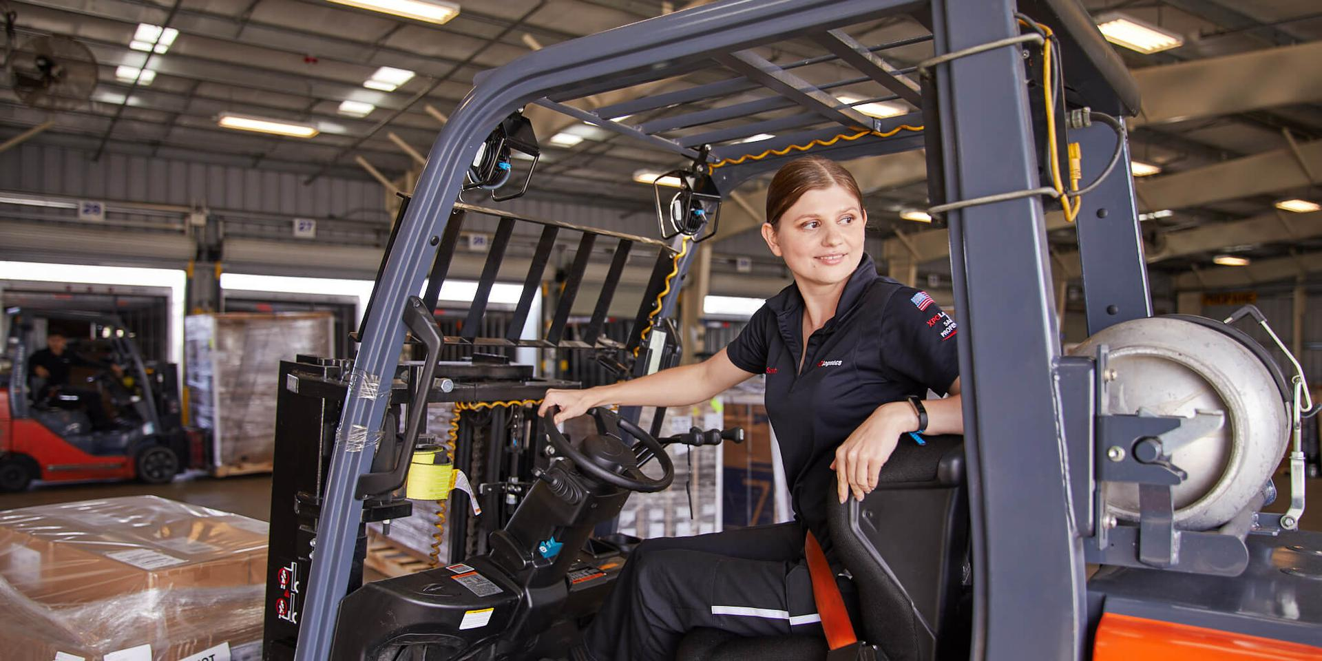 LTL forklift operator on dock