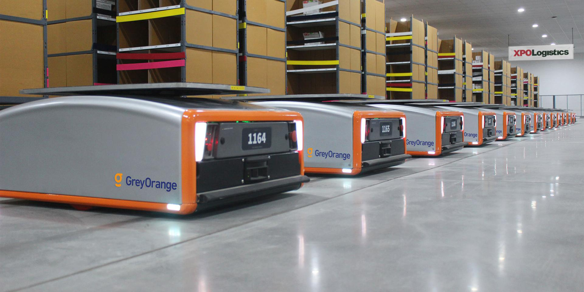 XPO GreyOrange robots lined up in warehouse
