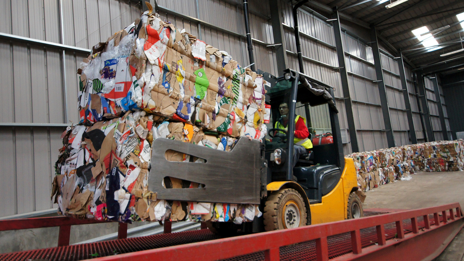 Forklift driver with waste to recycle