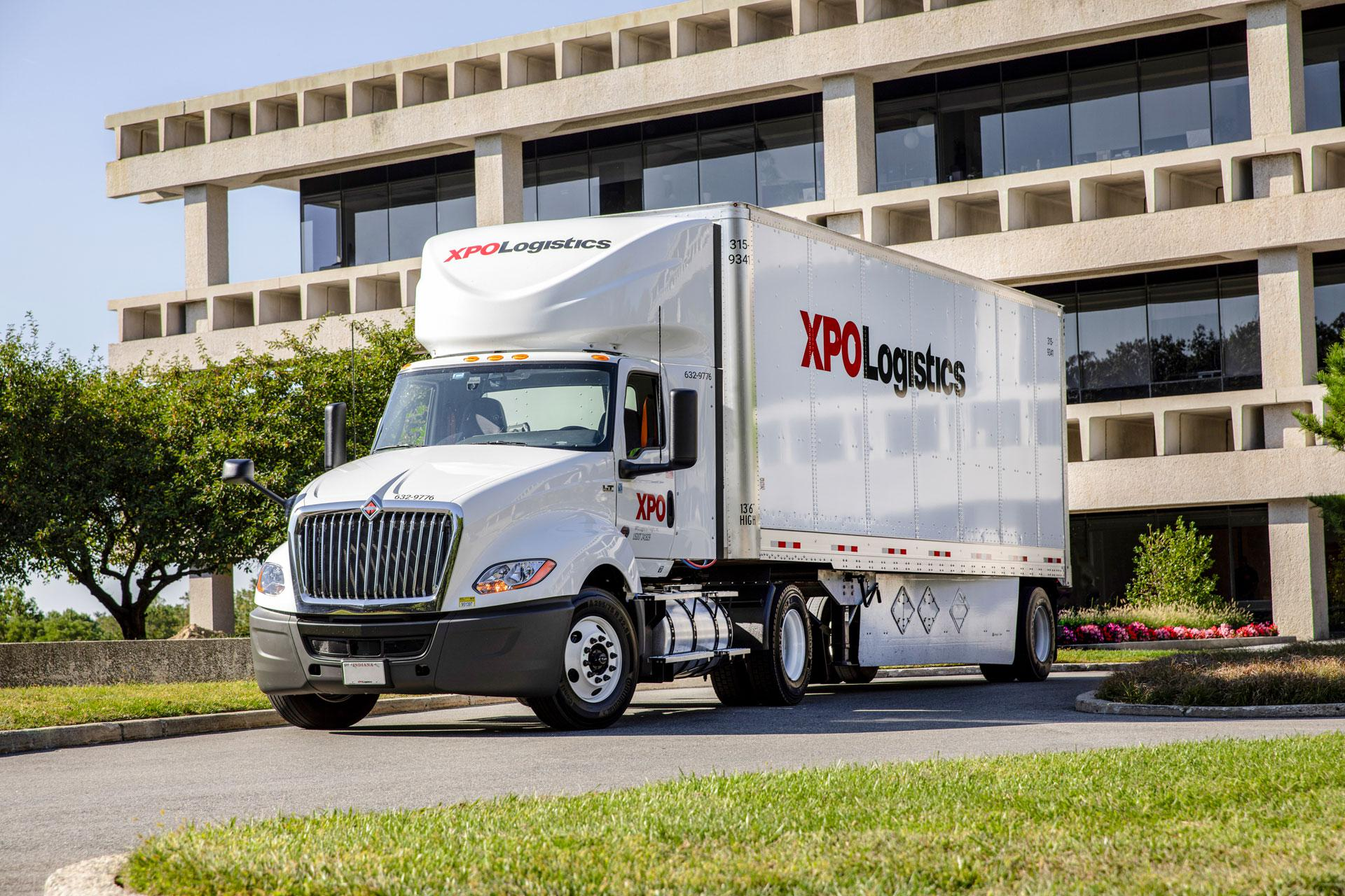An XPO LTL tractor-trailer, parked in front of XPO's Greenwich, CT headquarters