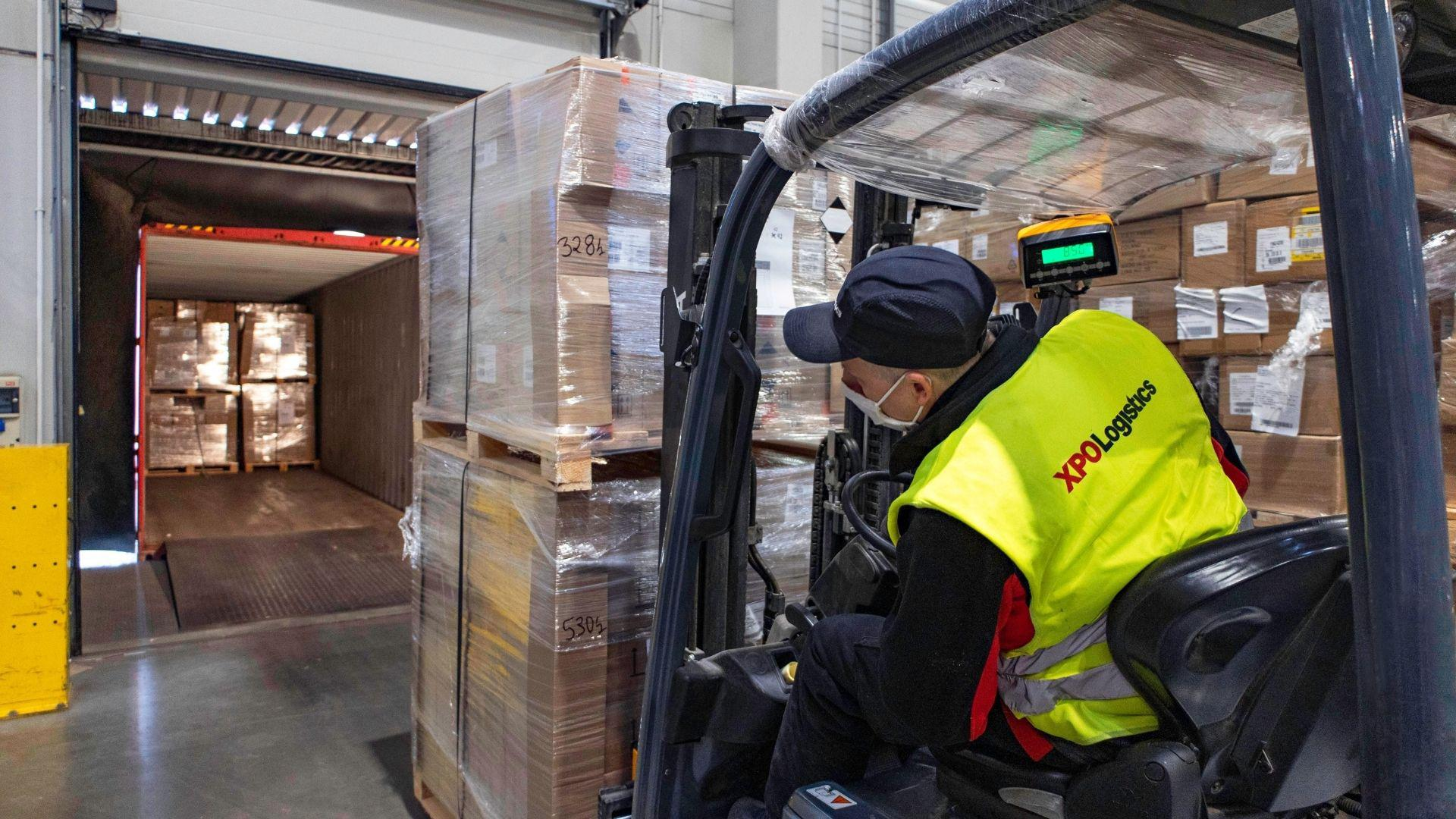 XPO forklift operator in a warehouse