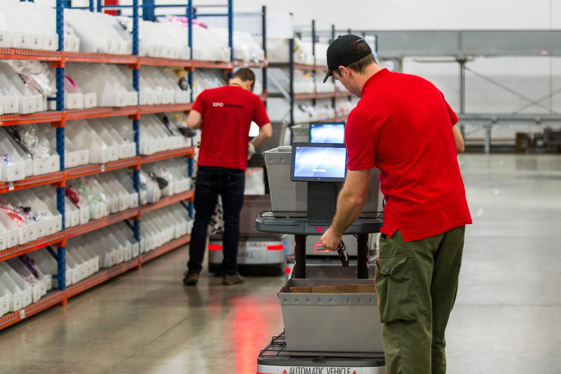 XPO employees partner with 6 River Systems collaborative robots to aid in picking and packing