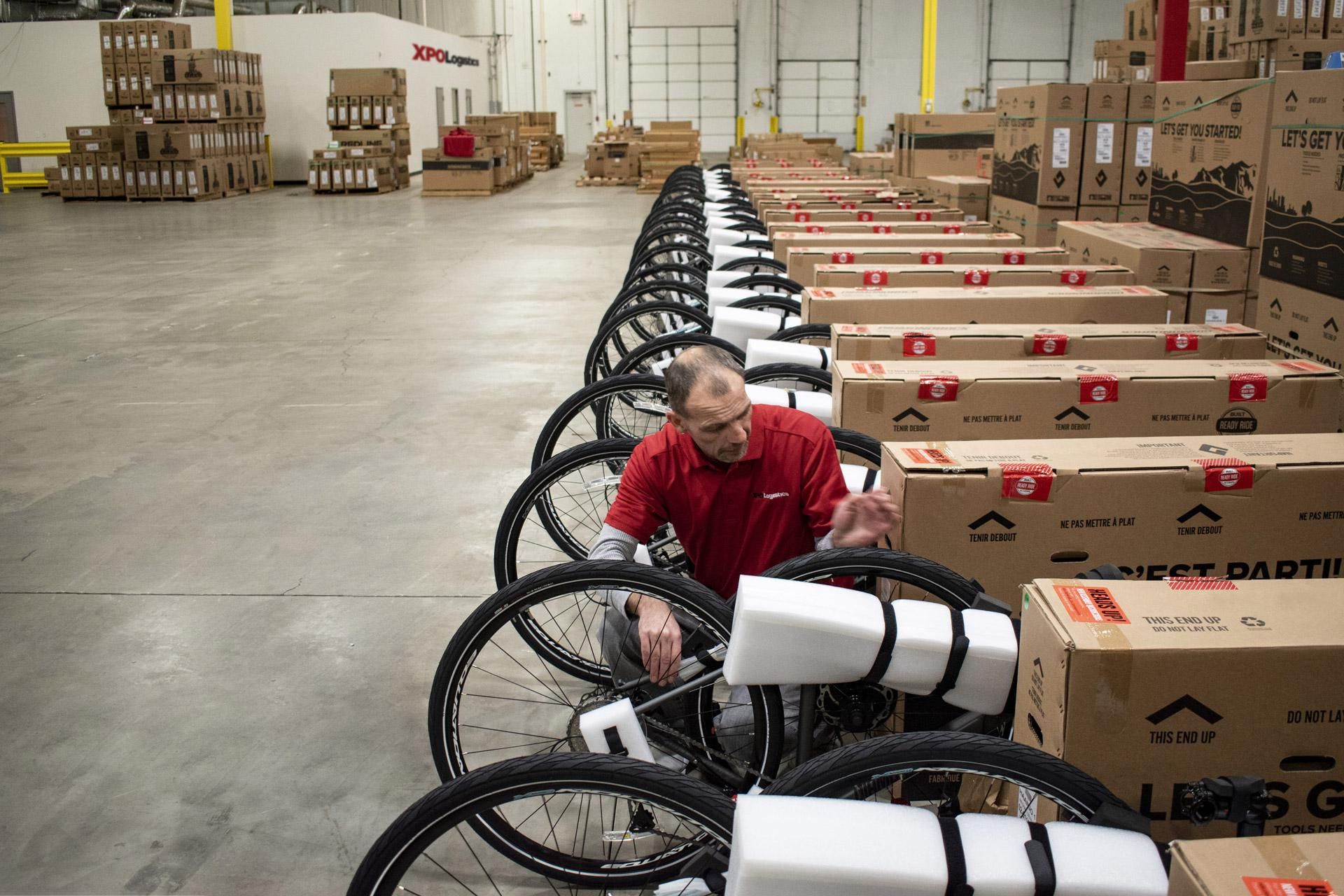 XPO employee assembles bikes before Last Mile delivery