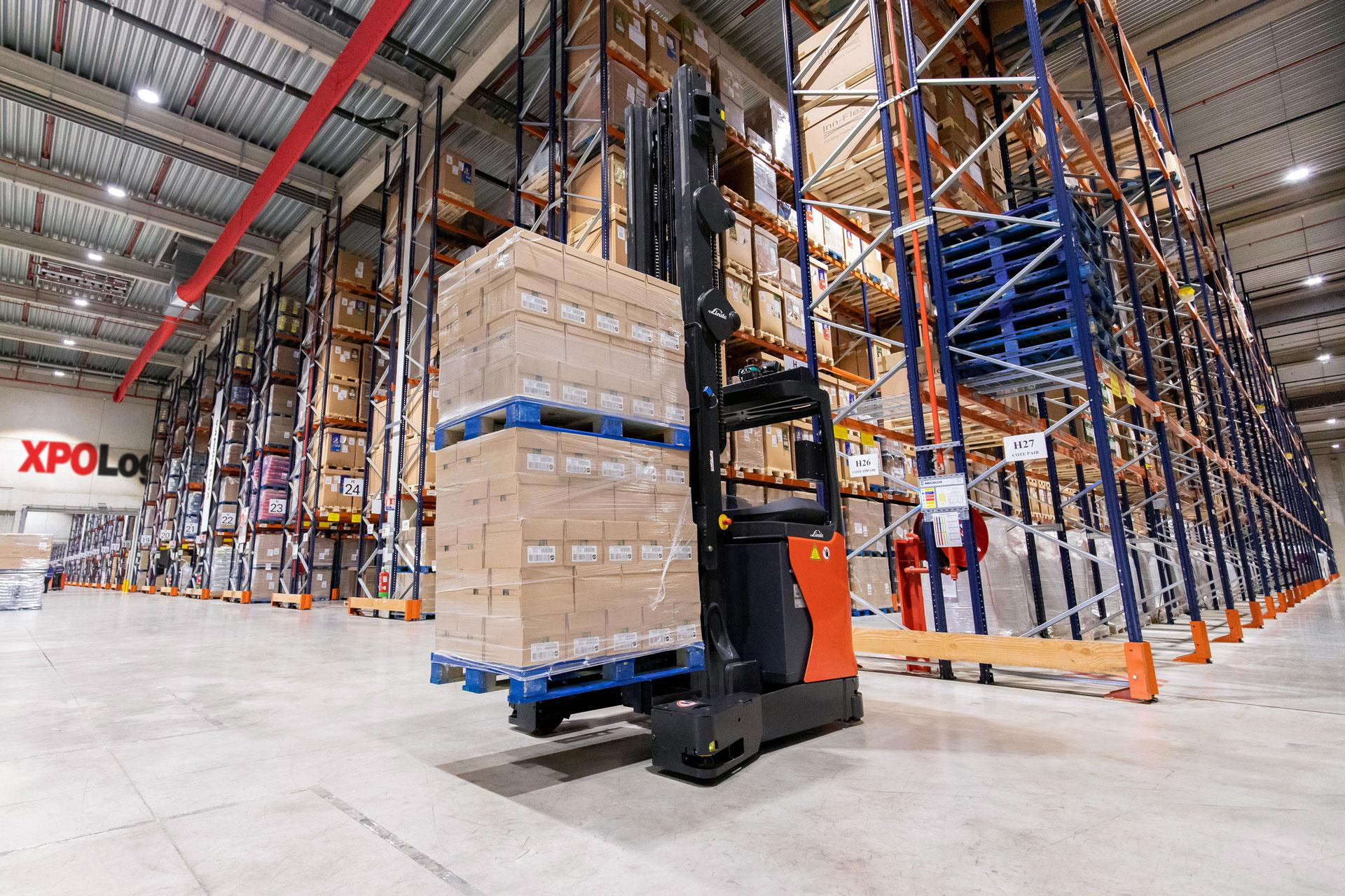 Forklift with goods in XPO warehouse.