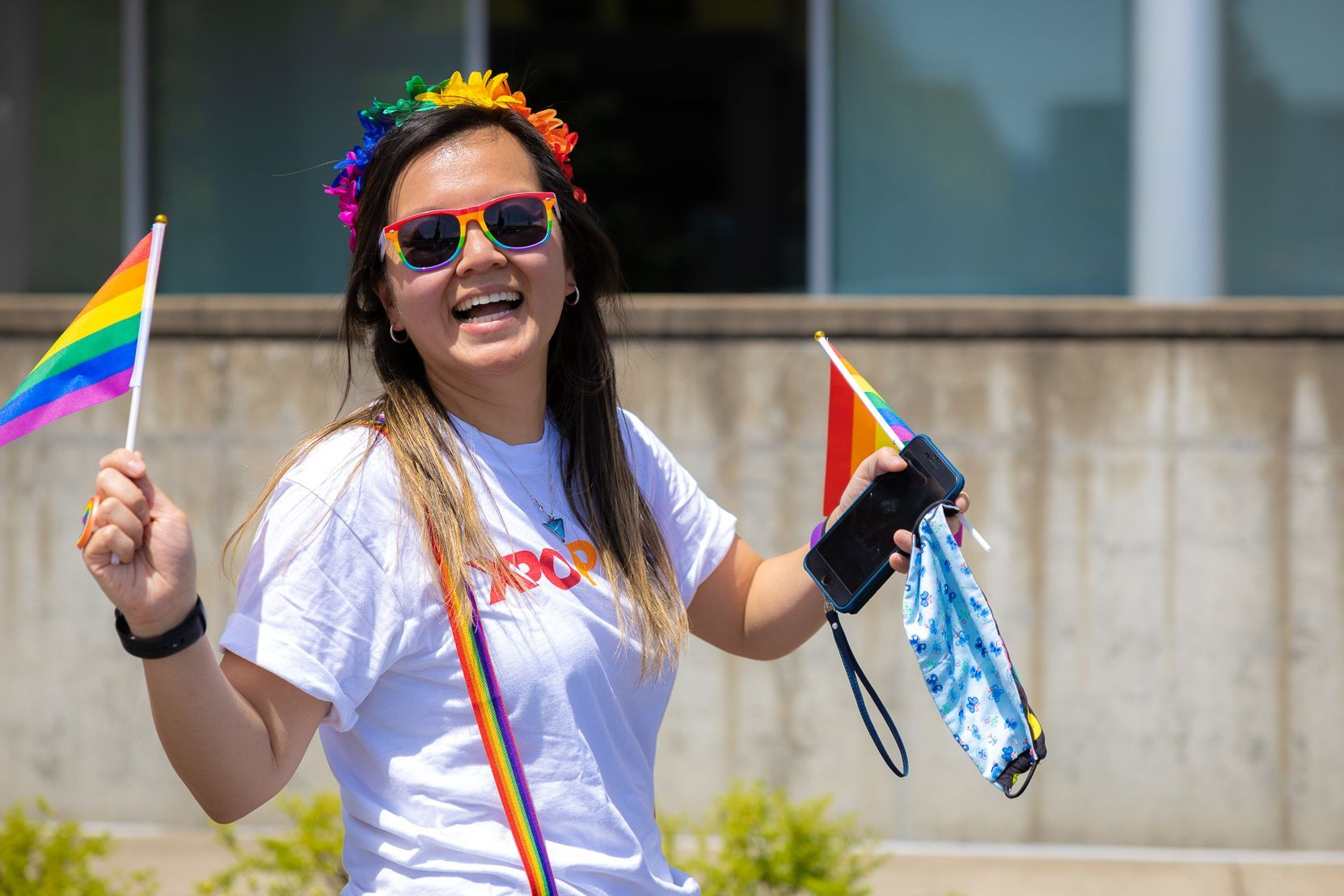 XPO employee holding rainbow flags