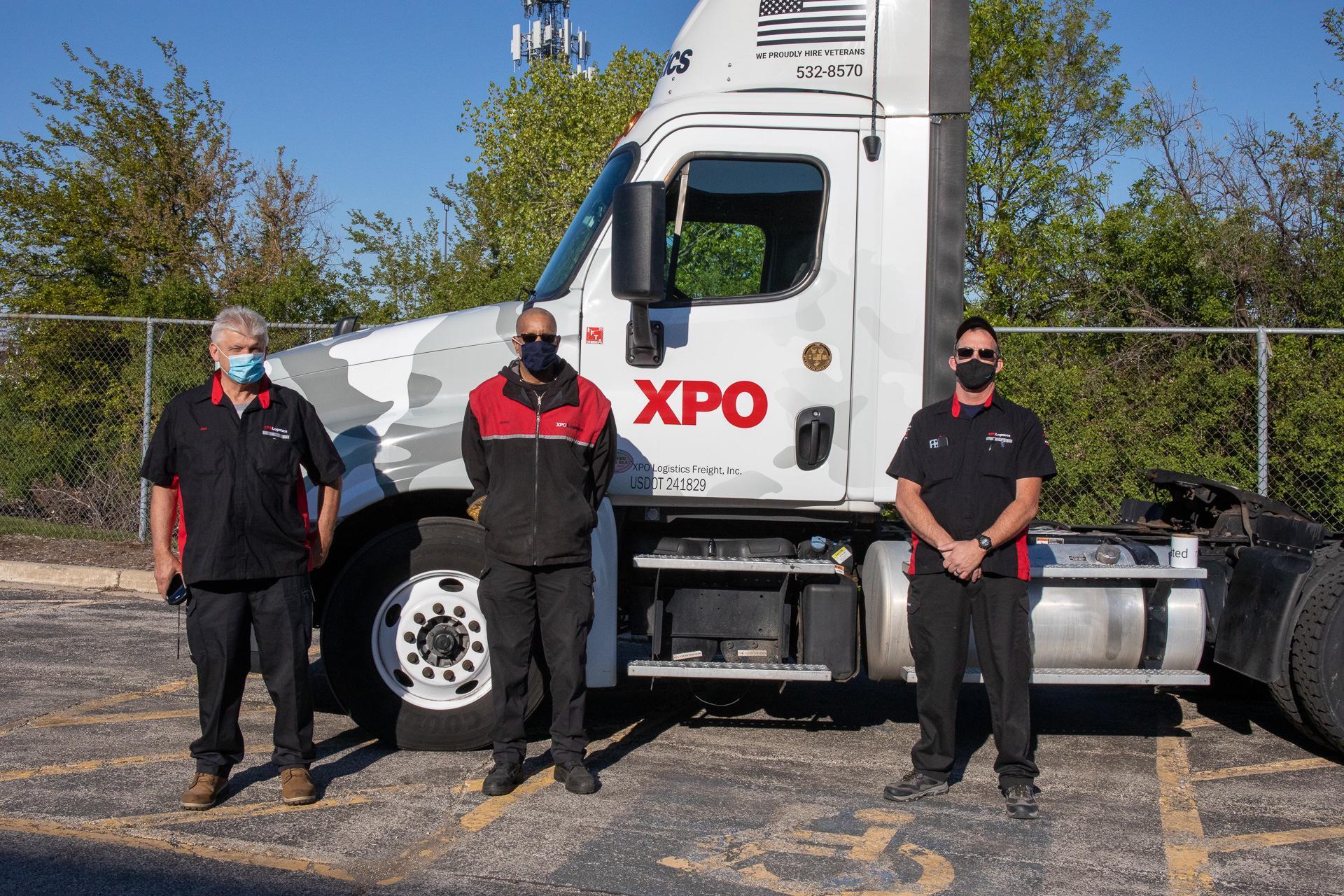 Veteran drivers in front of truck