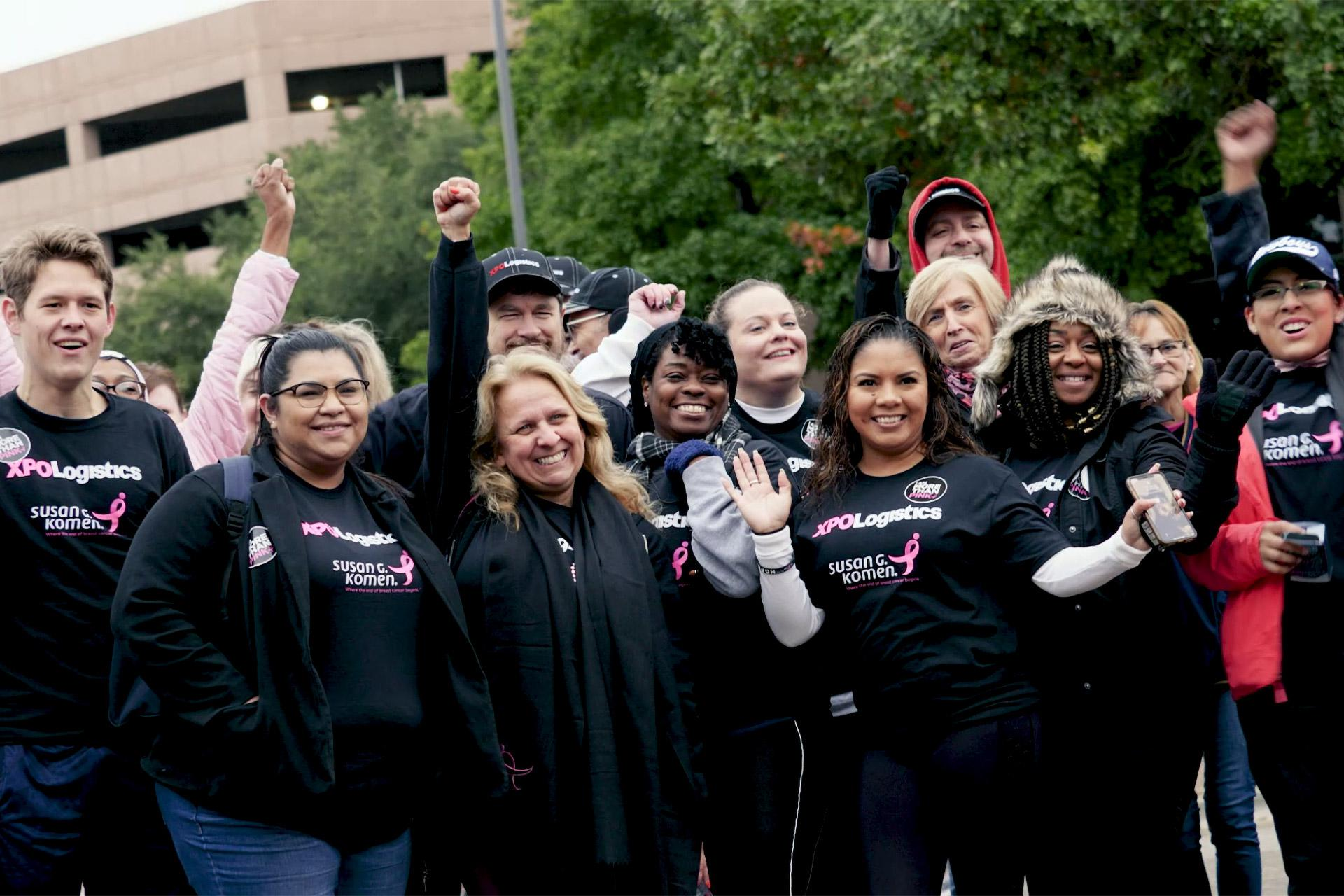 XPO Logistics employees cheer during a Susan G. Komen Race for the Cure
