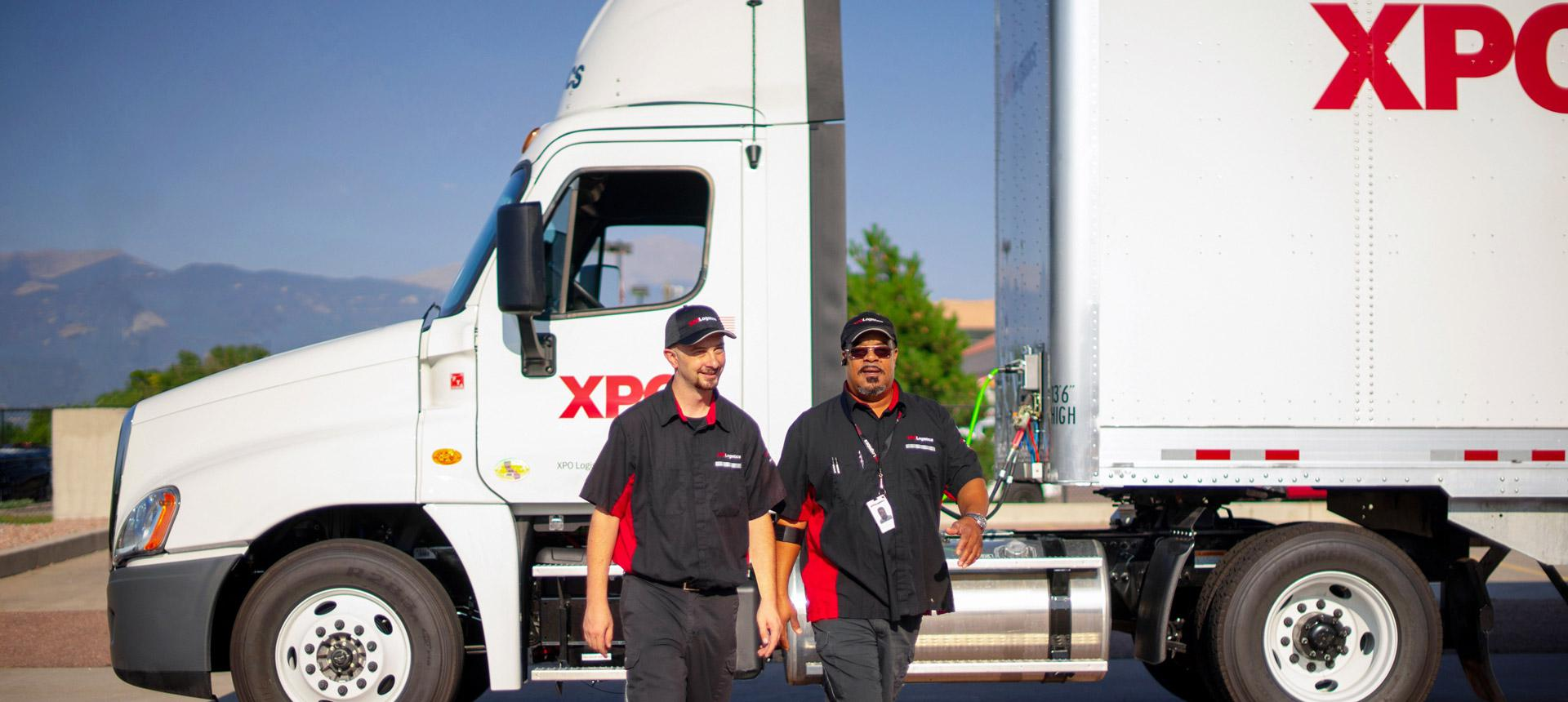 XPO drivers in front of truck