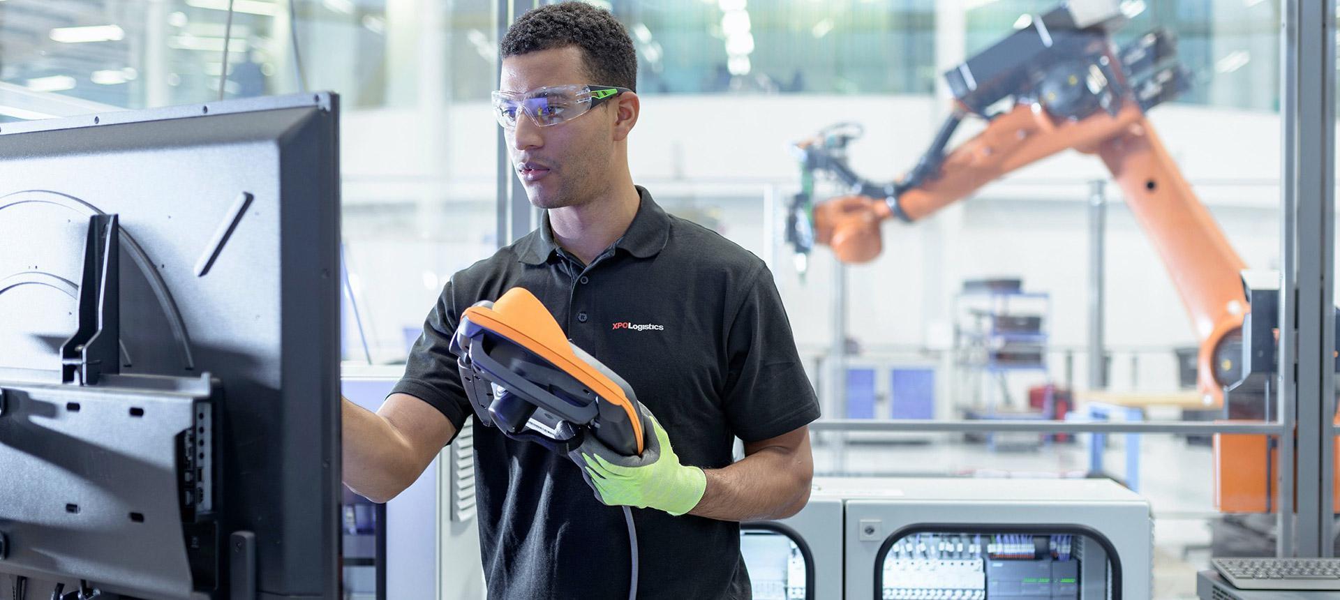 XPO employee holding robot