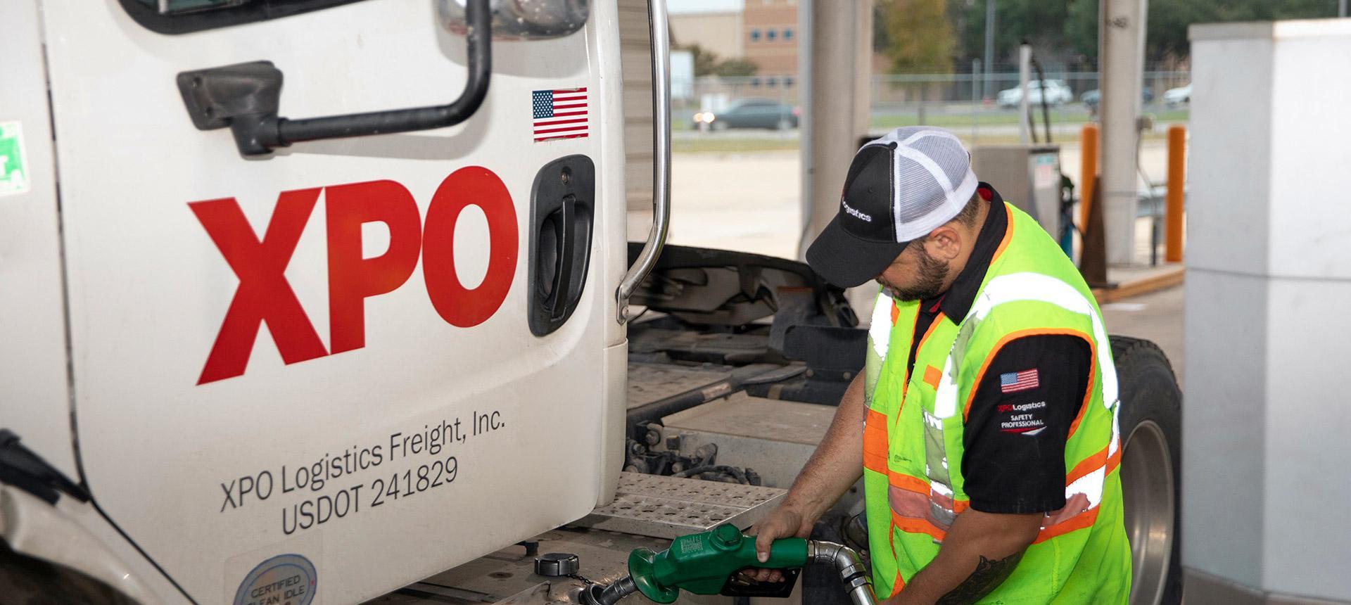 XPO employee filling truck