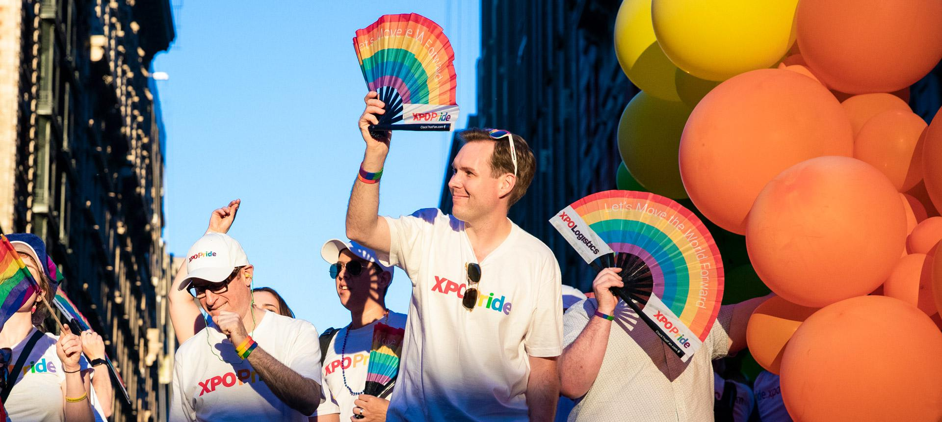 Employees on Pride float