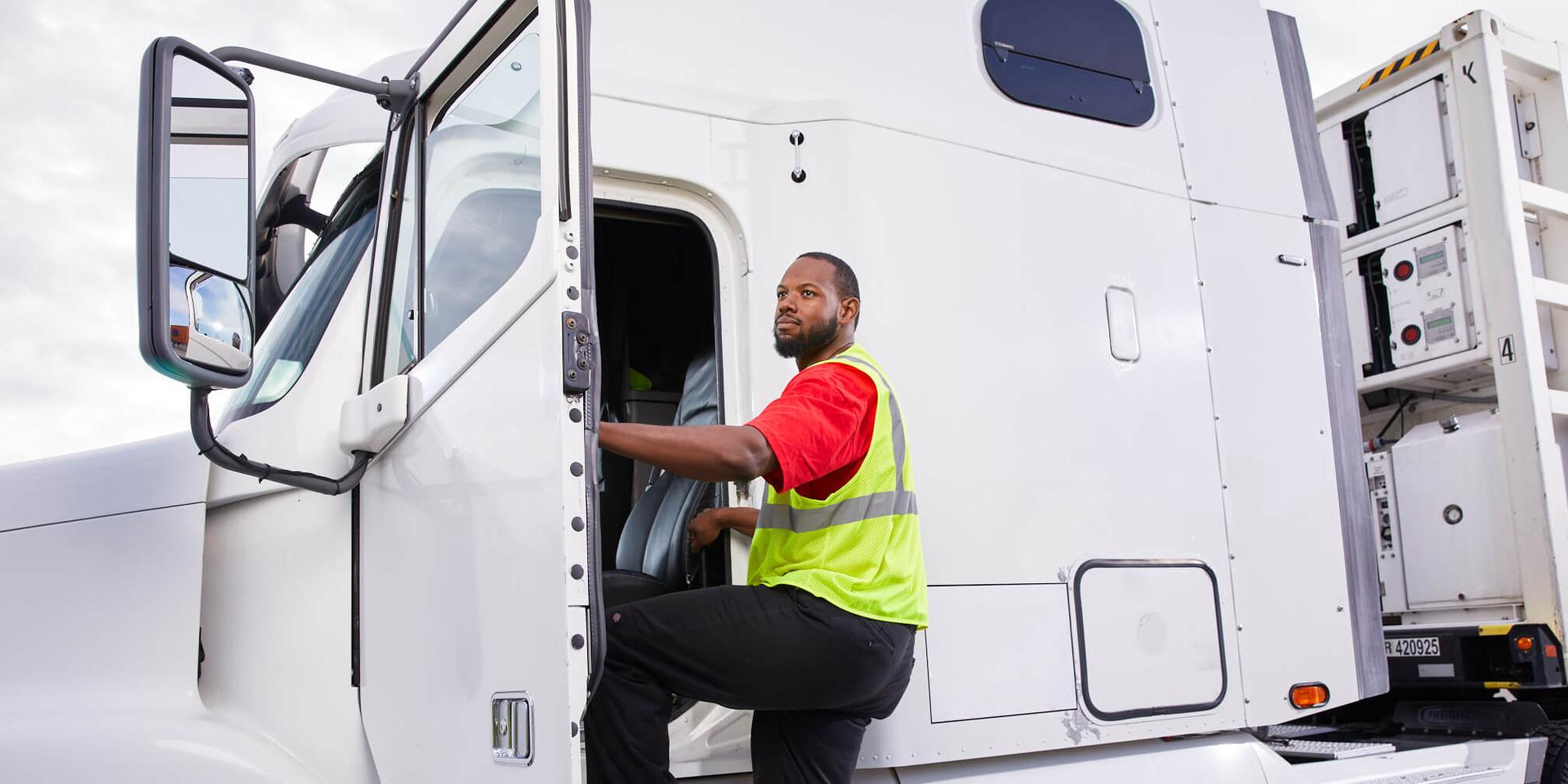 Driver entering truck cabin