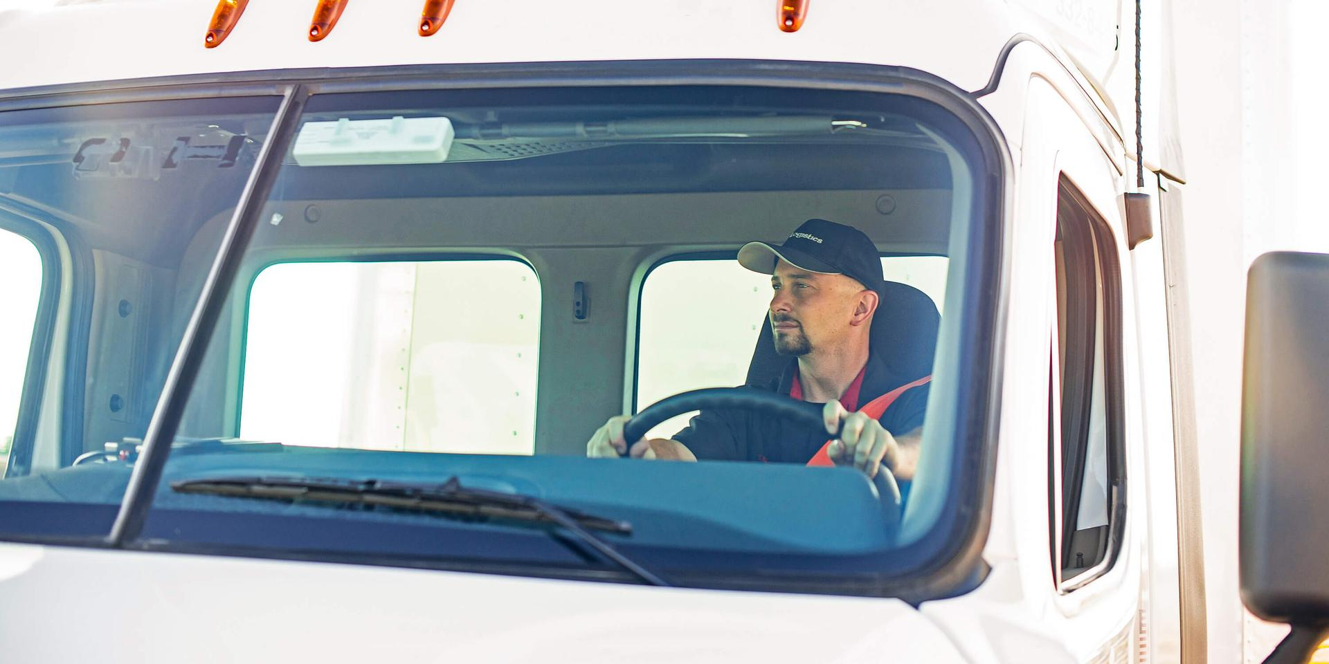 XPO LTL driver behind the wheel of truck